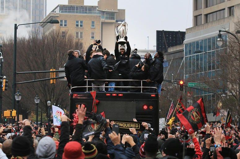 Atlanta United team members celebrate during victory parade