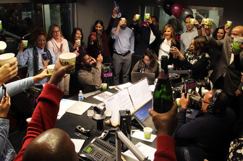 V-103's staff toasts The Morning Culture on the show's first day on air