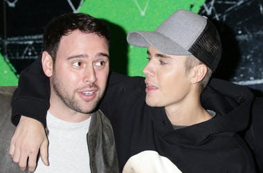 Scooter Braun (left) and Justin Bieber