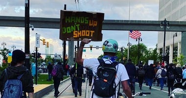 100 people arrested in Detroit protest