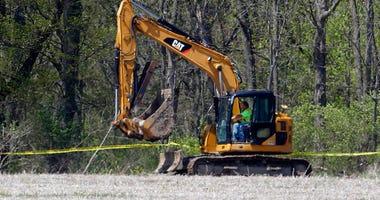 Macomb Township dig - AP