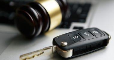 gavel and car key