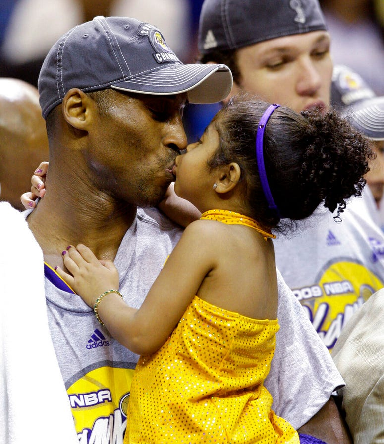 Kobe Bryant kisses his daughter, Gianna