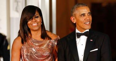 Obamas - AP