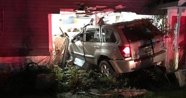 Orion SUV into house
