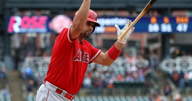Albert Pujols of the Los Angeles Angels flips his bat after hitting a home run for his 2,000th career RBI.