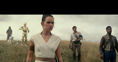Daisy Ridley, center, co-stars with  John Boyega and Oscar Isaac in Star Wars: The Rise of Skywalker