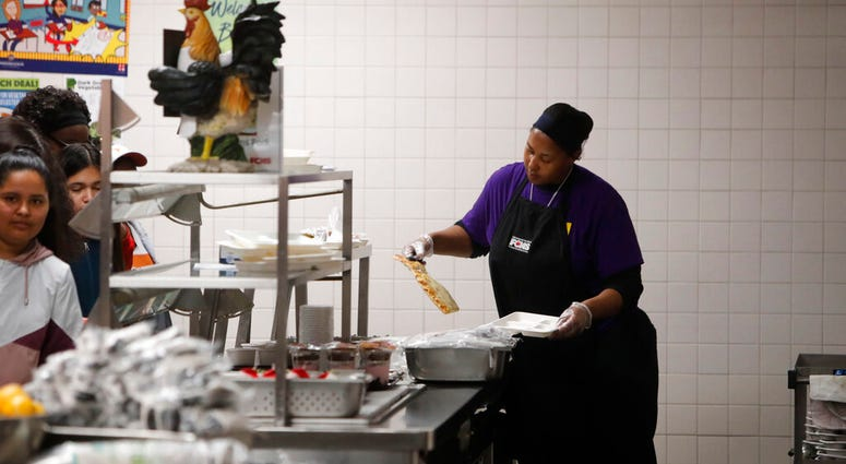 Nicole Johnson prepares lunch for students