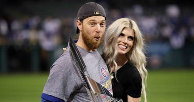 Ben Zobrist of the Chicago Cubs with his wife, Julianna, after being awarded the World Series MVP trophy in 2016.