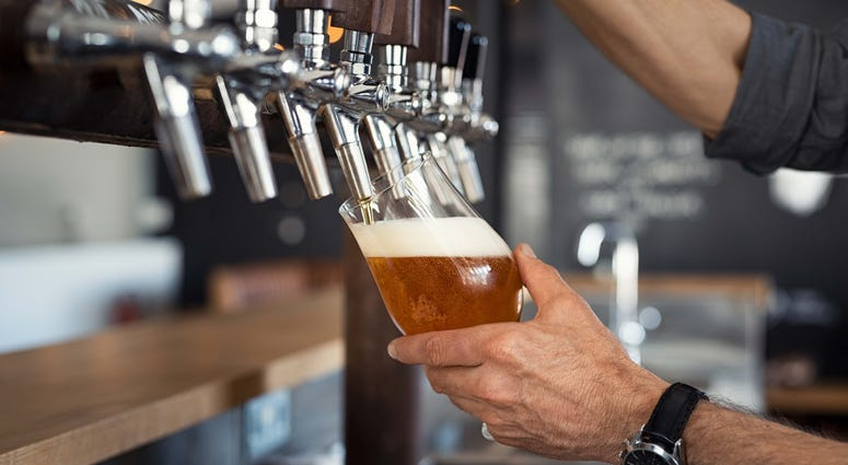 A draft beer pouring from a tap