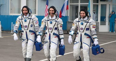 Astronauts Leave Virus-Plagued Planet For Space Station