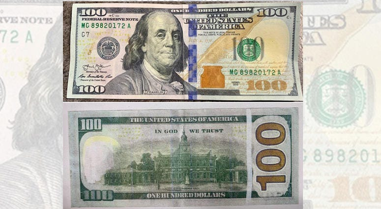 counterfeit cash holly police
