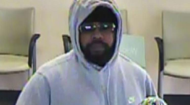 Hand Print On Exit Door Leads Police To Bank Robber