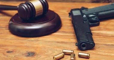 gavel and handgun