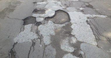 Potholes in Highland Park