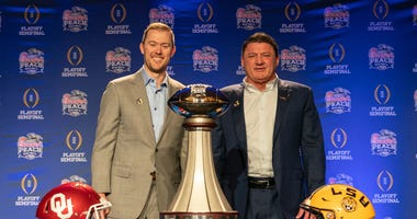 Oklahoma Sooners head coach Lincoln Riley and LSU Tigers head coach Ed Orgeron pose for a photo following their joint head coaches news conference on Friday, Dec. 27, in Atlanta. #4 Oklahoma will face #1 LSU in the 2019 College Football Playoff Semifinal.