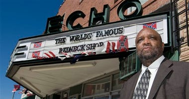 Rev. David Kennedy in front of old theater that housed Redneck Shop