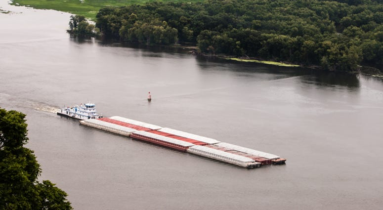 Mississippi River closed after barges collide, towboat sinks--three missing