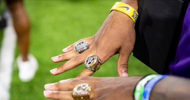 An LSU player shows off his championship rings at a ceremony held at the LSU practice facility Tuesday night.