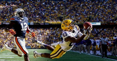 Oct 14, 2017; Baton Rouge, LA, USA; LSU Tigers wide receiver Russell Gage (83) dives for a touchdown catch past Auburn Tigers defensive back Jamel Dean (12) during the second quarter of a game at Tiger Stadium.