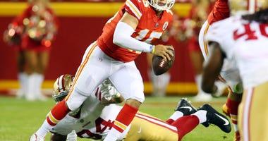 Kansas City Chiefs quarterback Patrick Mahomes II (15) evades San Francisco 49ers defensive lineman Solomon Thomas (94) in the second half at Arrowhead Stadium.