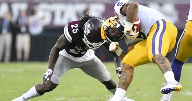 Sep 16, 2017; Starkville, MS, USA; Mississippi State Bulldogs defensive back Lashard Durr (25) and LSU Tigers running back Derrius Guice (5) collide during the first quarter at Davis Wade Stadium