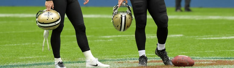 New Orleans Saints kicker Wil Lutz (3) and long snapper Zach Wood (49) react during the NFL International Series game against the Miami Dolphins at Wembley Stadium. The Saints defeated the Dolphins 20-0.
