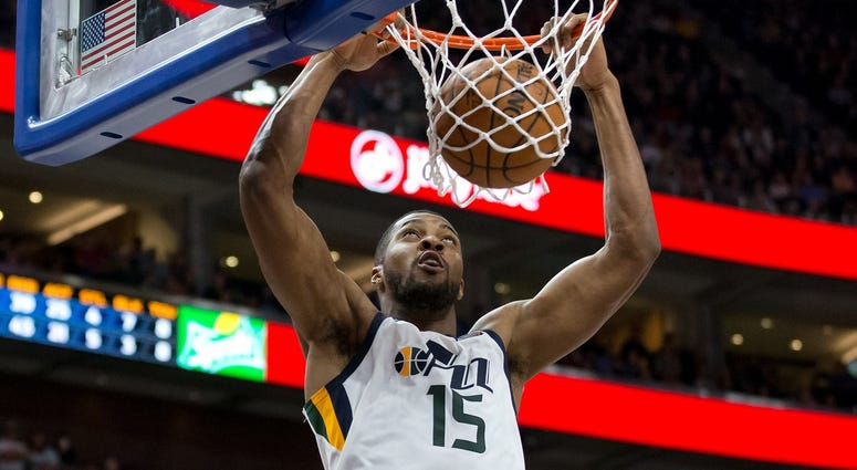 Dec 1, 2017; Salt Lake City, UT, USA; Utah Jazz forward Derrick Favors (15) dunks the ball during the second half against the New Orleans Pelicans at Vivint Smart Home Arena.