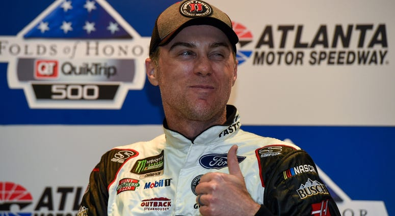 Feb 25, 2018; Hampton, GA, USA; Monster Energy NASCAR Cup Series driver Kevin Harvick (4) reacts to a question while talking with media after winning the Folds of Honor QuikTrip 500 at Atlanta Motor Speedway.