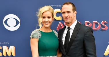 Drew Brees, right, with his wife Brittany arrive prior to the 53rd Academy of Country Music Awards at the MGM Grand Garden Arena.