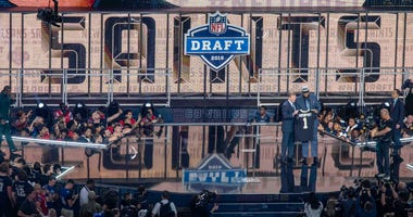 NFL commissioner Roger Godell announces the pick of Texas-San Antonio defensive end Marcus Davenport by the New Orleans Saints during the 2018 NFL Draft at AT&T Stadium.
