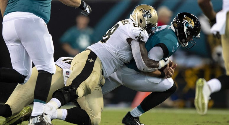 Aug 9, 2018; Jacksonville, FL, USA; Jacksonville Jaguars quarterback Tanner Lee (3) is sacked by New Orleans Saints defensive tackle Devaroe Lawrence (68) in the second half of the game at TIAA Bank Field.