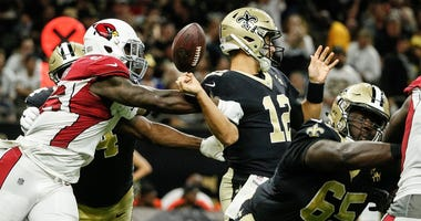 Aug 17, 2018; New Orleans, LA, USA; Arizona Cardinals defensive end Jacquies Smith (96) strips New Orleans Saints quarterback Tom Savage (12) during the second half of a preseason game at the Mercedes-Benz Superdome. The Cardinals defeated the Saints 20-1