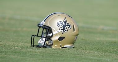 Saints helmet on the field