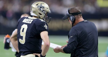 Sep 9, 2018; New Orleans, LA, USA; New Orleans Saints head coach Sean Payton talks to quarterback Drew Brees (9) in the second half against the Tampa Bay Buccaneers at the Mercedes-Benz Superdome. The Bucs won, 48-40.