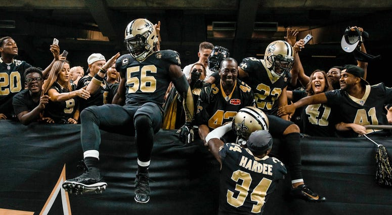 Sep 16, 2018; New Orleans, LA, USA; New Orleans Saints linebacker Demario Davis (56) and cornerback Marshon Lattimore (23) and cornerback Justin Hardee (34) celebrate with fans in the stands after a missed field goal by Cleveland Browns place kicker Zane
