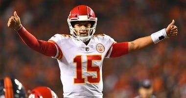 Oct 1, 2018; Denver, CO, USA; Kansas City Chiefs quarterback Patrick Mahomes (15) calls an audible in the third quarter against the against the Denver Broncos at Broncos Stadium at Mile High