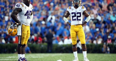 Oct 6, 2018; Gainesville, FL, USA; LSU Tigers linebacker Devin White (40) and LSU Tigers cornerback Kristian Fulton (22) look on during the fourth quarter against the Florida Gators during the second half at Ben Hill Griffin Stadium.
