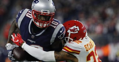 Oct 14, 2018; Foxborough, MA, USA; New England Patriots wide receiver Josh Gordon (10) runs after a catch against Kansas City Chiefs defensive back Orlando Scandrick (22) in the second half at Gillette Stadium. The Patriots defeated Kansas City 43-40.