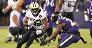 New Orleans Saints tight end Ben Watson (82) gains yards after the catch defended by Baltimore Ravens safety Tony Jefferson (23) at M&T Bank Stadium.