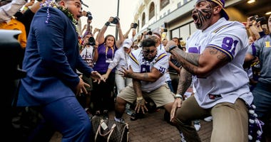 LSU Tigers defensive end Breiden Fehoko (left) performs a traditional Haka dance with his father Vili Fehoko and brother Sam Fehoko prior to kickoff against the Alabama Crimson Tide at Tiger Stadium.