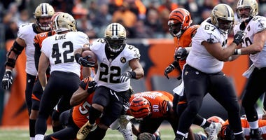 Nov 11, 2018; Cincinnati, OH, USA; New Orleans Saints running back Mark Ingram (22) carries the ball against the Cincinnati Bengals in the second half at Paul Brown Stadium.