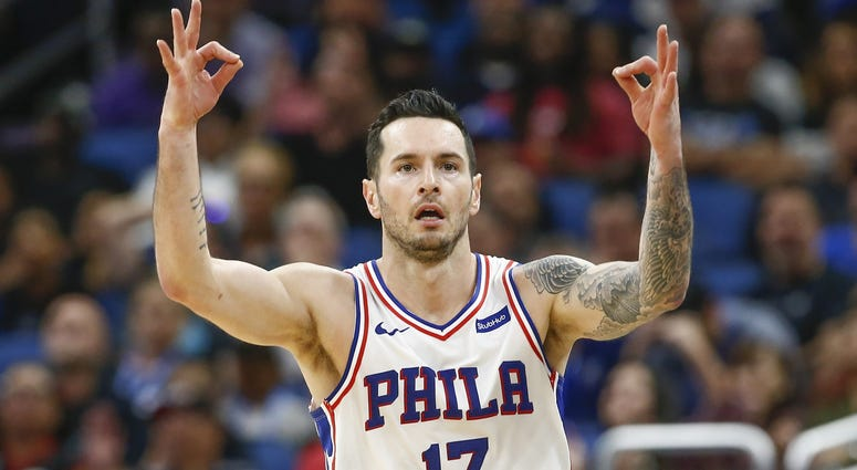 Nov 14, 2018; Orlando, FL, USA; Philadelphia 76ers guard JJ Redick (17) signals after a three-point basket during the second half against the Orlando Magic at Amway Center.