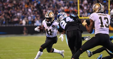New Orleans Saints wide receiver Tommylee Lewis (11) runs as Carolina Panthers cornerback James Bradberry (24) defends in the fourth quarter at Bank of America Stadium.