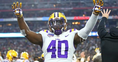 Jan 1, 2019; Glendale, AZ, USA; LSU Tigers linebacker Devin White (40) reacts in the fourth quarter against the UCF Knights in the 2019 Fiesta Bowl at State Farm Stadium.