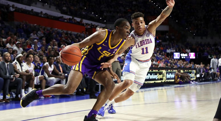 Mar 6, 2019; Gainesville, FL, USA; LSU Tigers guard Javonte Smart (1) drives to the basket as Florida Gators forward Keyontae Johnson (11) defends during the first half at Exactech Arena