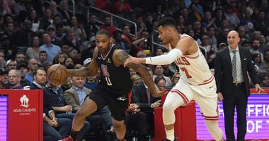 LA Clippers guard Sindarius Thornwell (0) brings the ball up court against Chicago Bulls guard Timothe Luwawu-Cabarrot (7) in the second half at The Clippers defeated the Bulls 128-121.