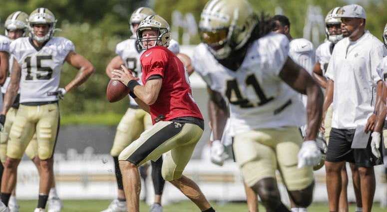 Jul 28, 2019; Metairie, LA, USA; New Orleans Saints quarterback Drew Brees (9) throws to running back Alvin Kamara (41) during training camp at the Ochsner Sports Performance Center.