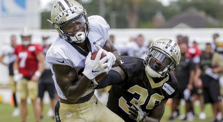 Jul 28, 2019; Metairie, LA, USA; New Orleans Saints wide receiver Emmanuel Butler (17) catches a pass over defensive back Kayvon Webster (39) during training camp at the Ochsner Sports Performance Center.
