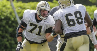 Jul 28, 2019; Metairie, LA, USA; New Orleans Saints offensive tackle Ryan Ramczyk (71) works against offensive tackle Derrick Kelly (68) during training camp at the Ochsner Sports Performance Center.